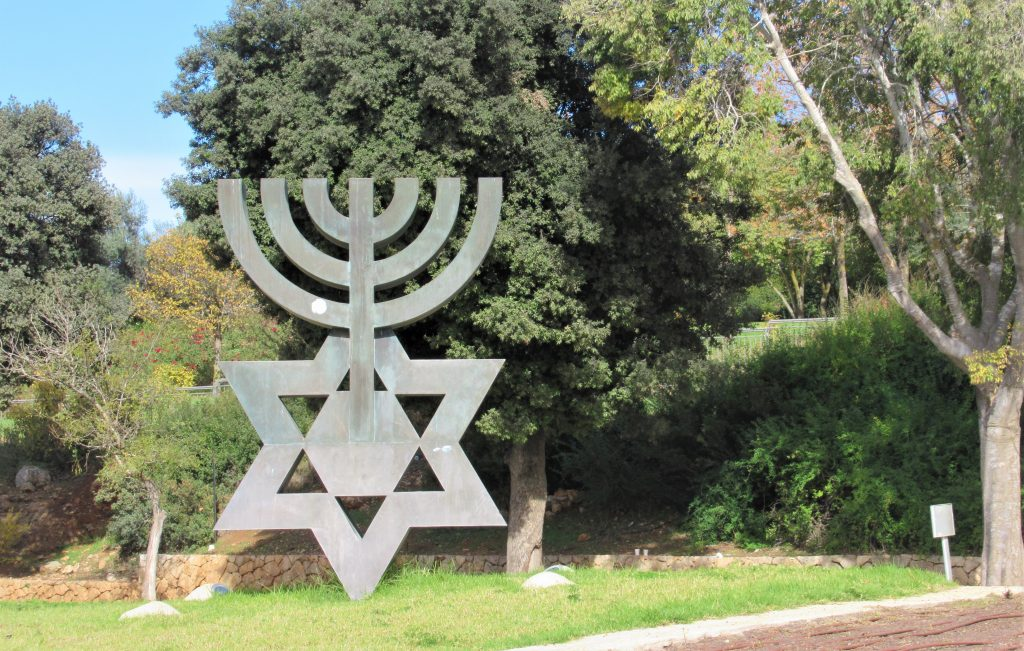 Menorah and Jewish star near entrance to Knesset road