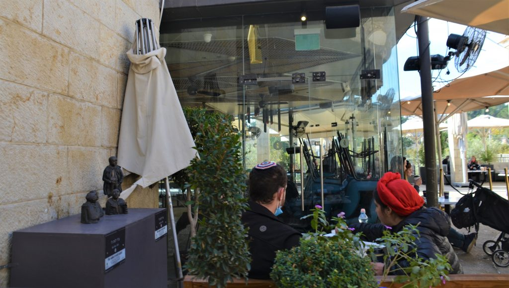 People eating outside during COVID-19 as takeout food was legal, cut inside dining forbidden.