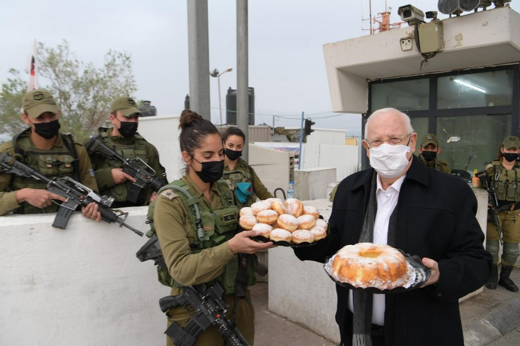 President Rivlin giving donuts to soldiers