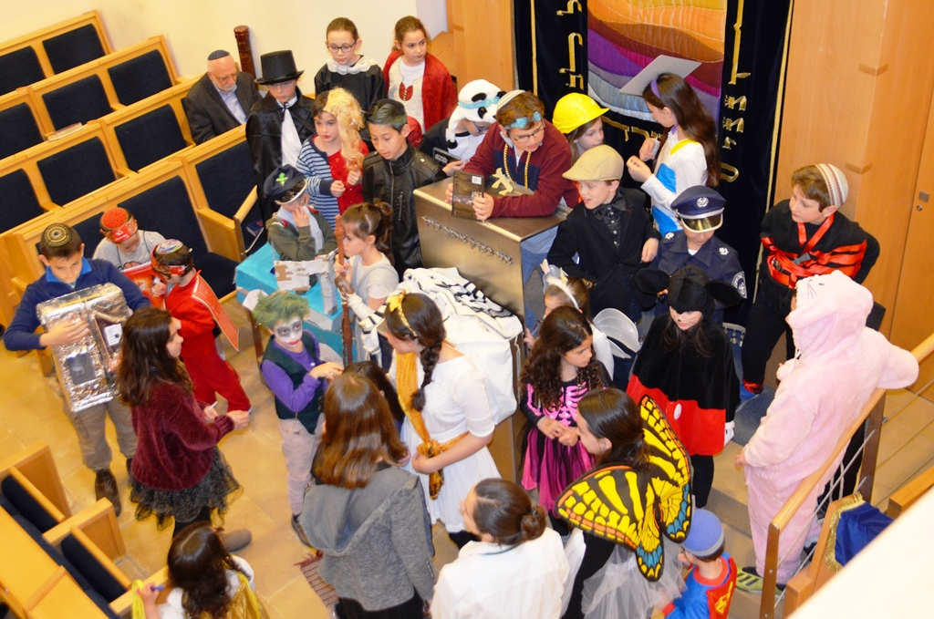 children dressed in costumes for Purim