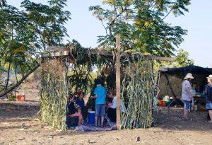 Simple style natural sukka on moshav in fields
